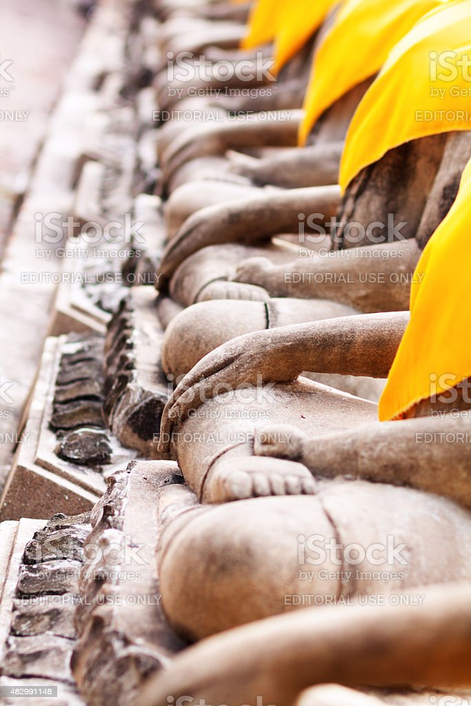 Folded legs and hands of buddhas stock photo