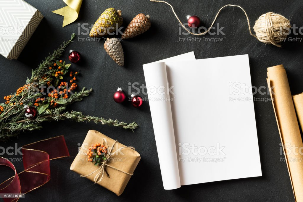 Folded magazine with blank page in Christmas concept flat lay stock photo