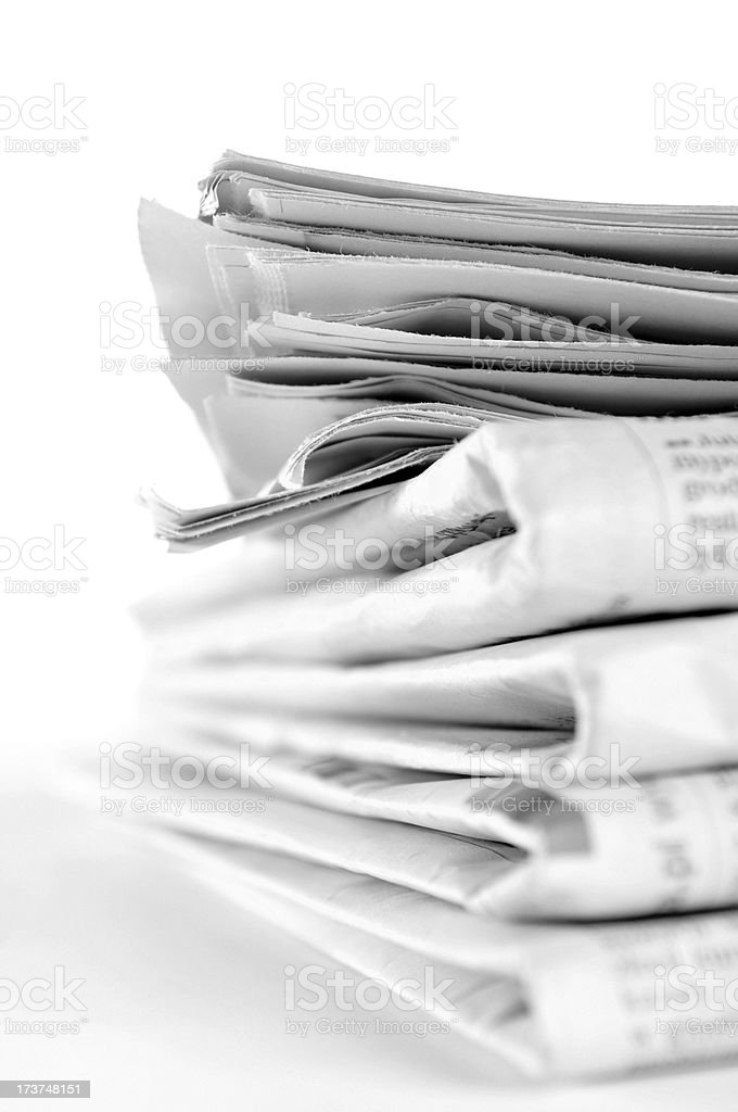 Folded Newspapers lying on the table royalty-free stock photo