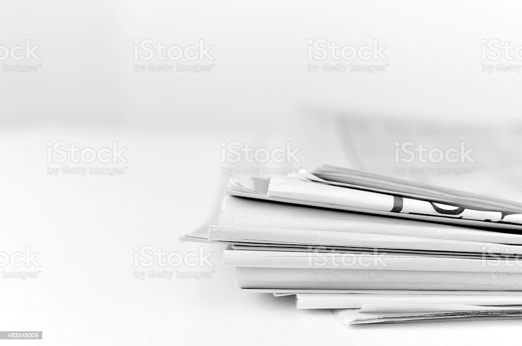 Folded newspapers stock photo