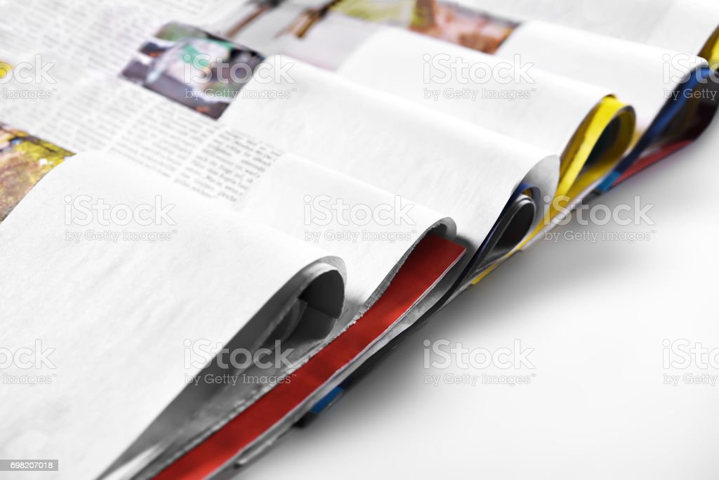 Folded newspapers. Selective focus. Copy space. stock photo