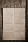 folded note paper on wood