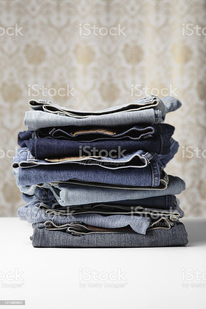 Folded old Blue Jeans stock photo