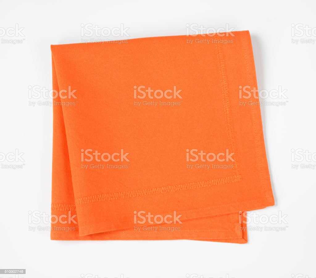 Folded orange napkin stock photo