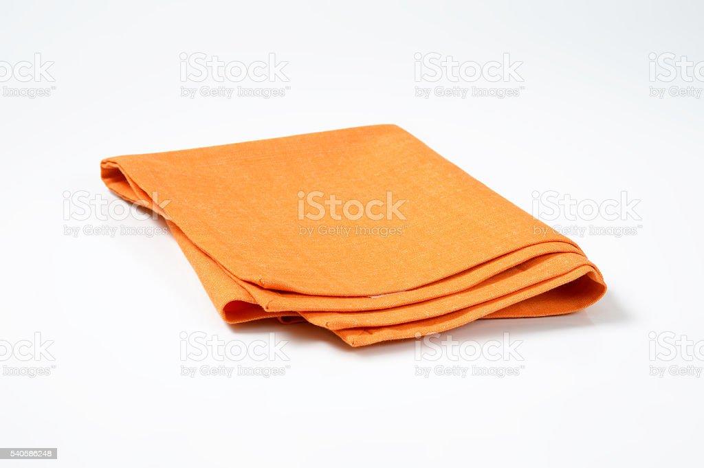 folded orange napkin stock photo