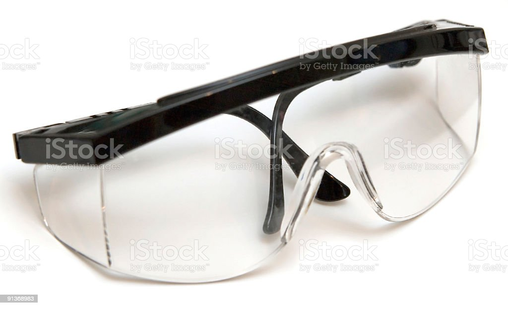 Folded pair of safety glasses on a white background royalty-free stock photo