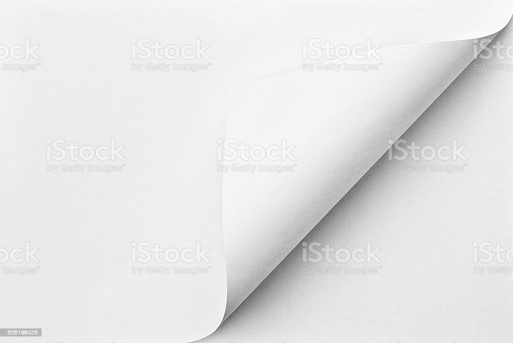 Folded sheet of paper with curled corner stock photo