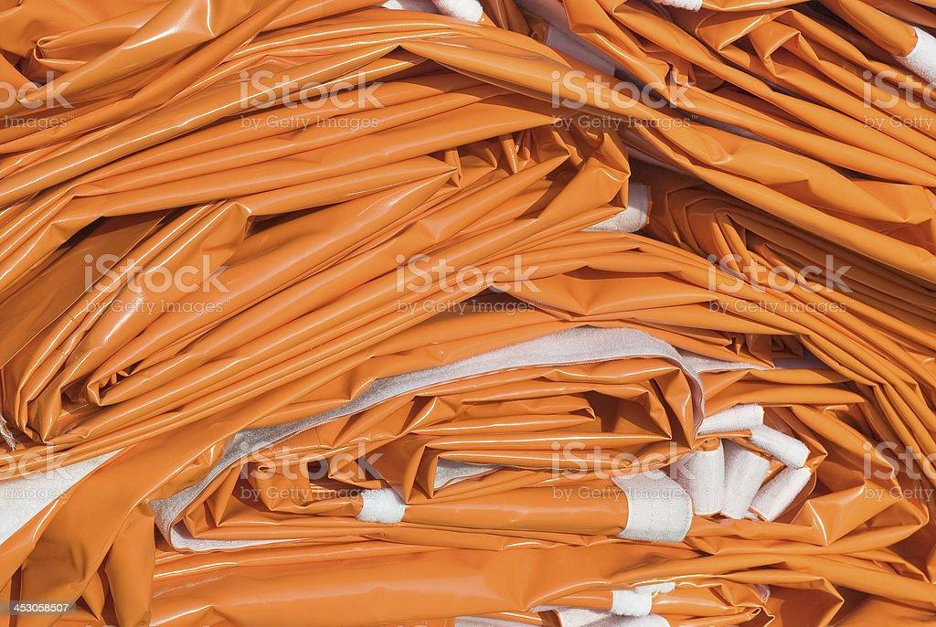 Folded Tarpaulin in Orange stock photo