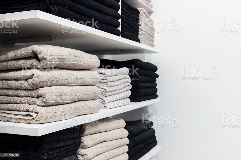 folded towels on white shelf stock photo