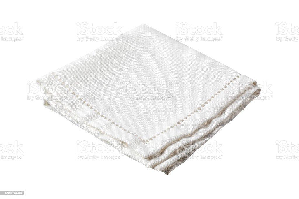 Folded white napkin with embroidered border stock photo