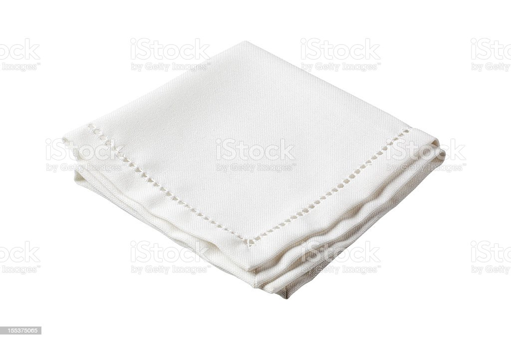 Folded white napkin with embroidered border stock photo