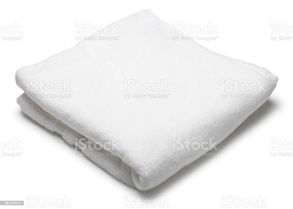 Folded white terrycloth towel on white background stock photo