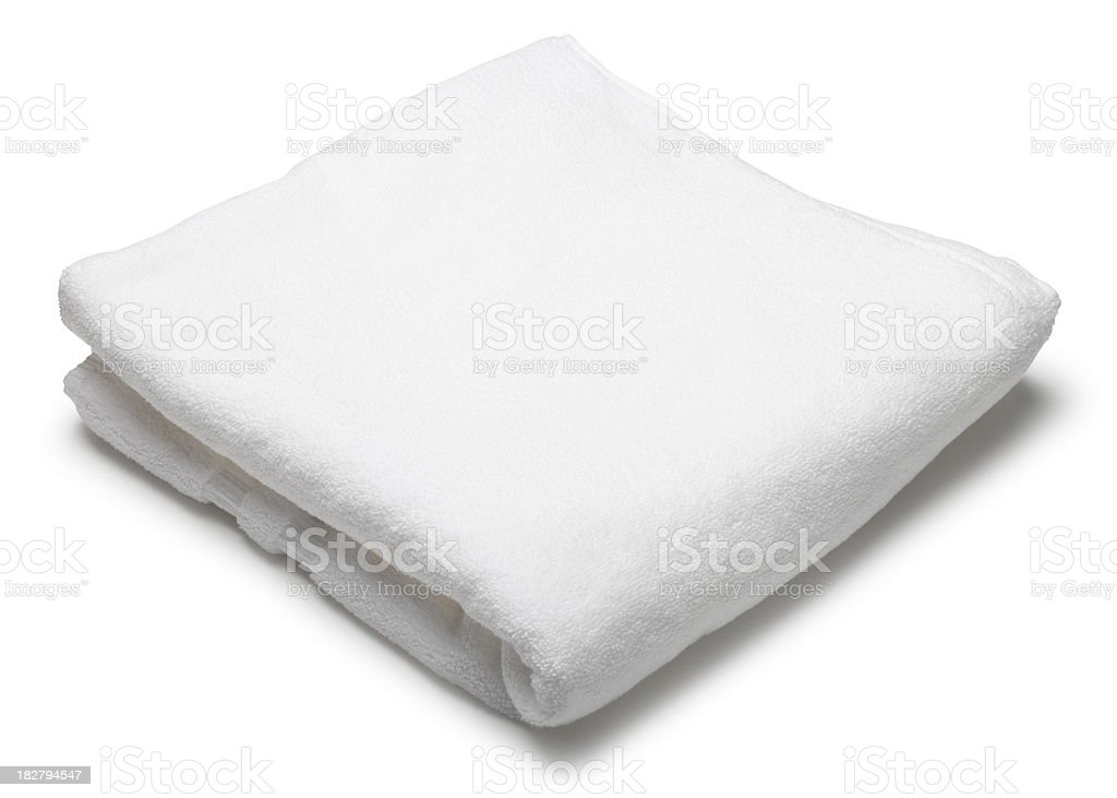 Folded white terrycloth towel on white background stock photo
