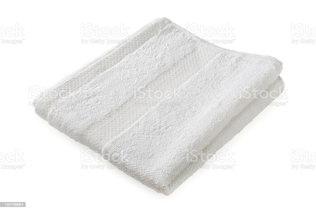 A folded white towel on a white background stock photo