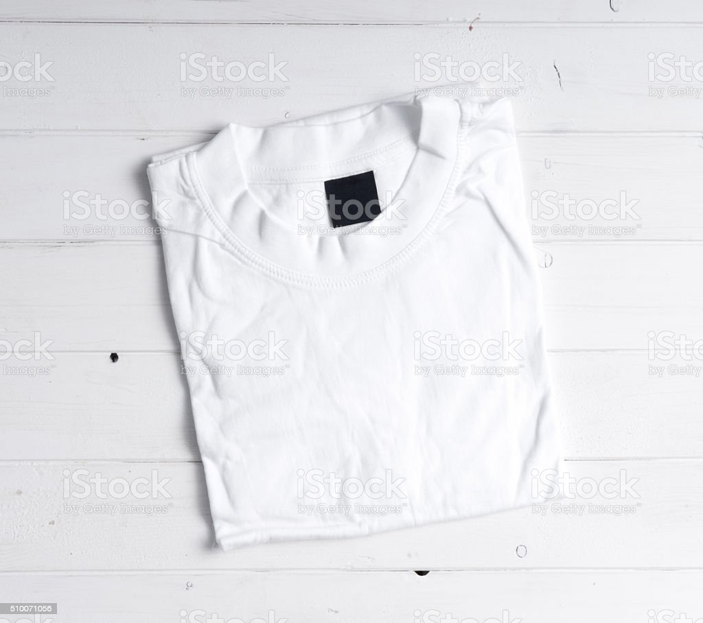 folded white t-shirt stock photo