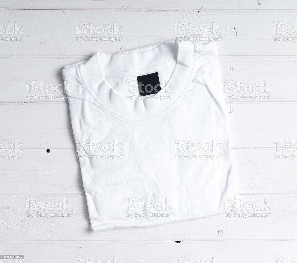 folded white t-shirt stock photo