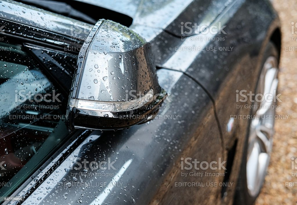 Folded wing mirror on a modern motor car stock photo