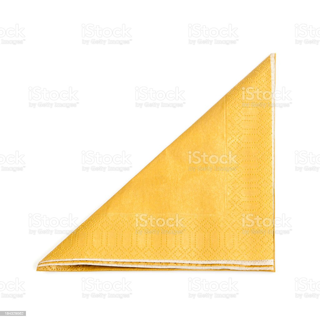 A folded yellow napkin on a white background stock photo