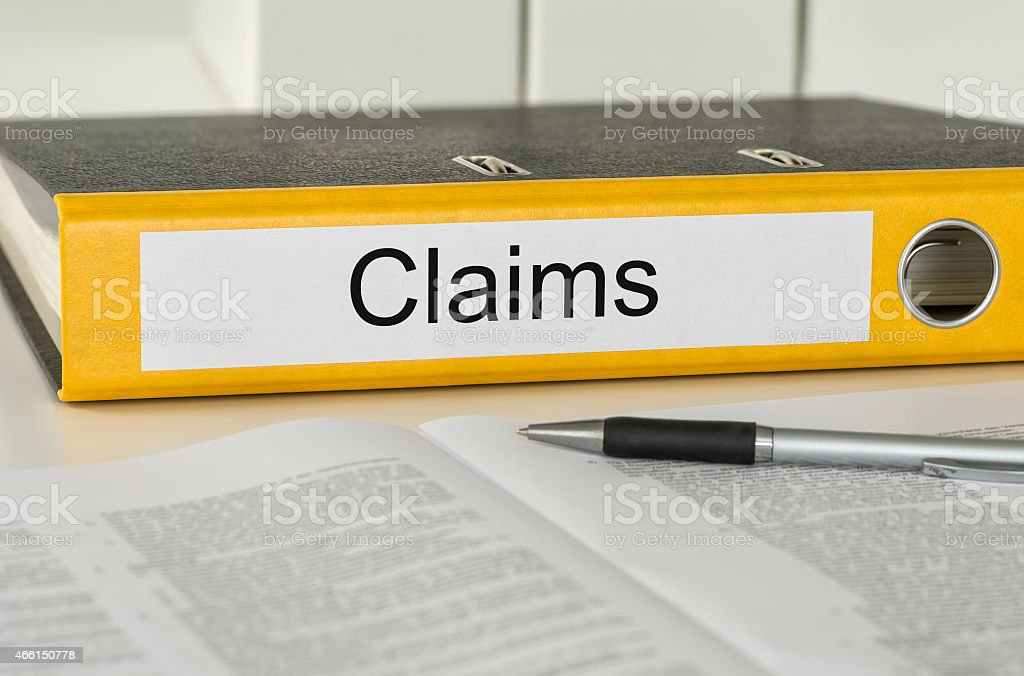 Folder with the label Claims stock photo