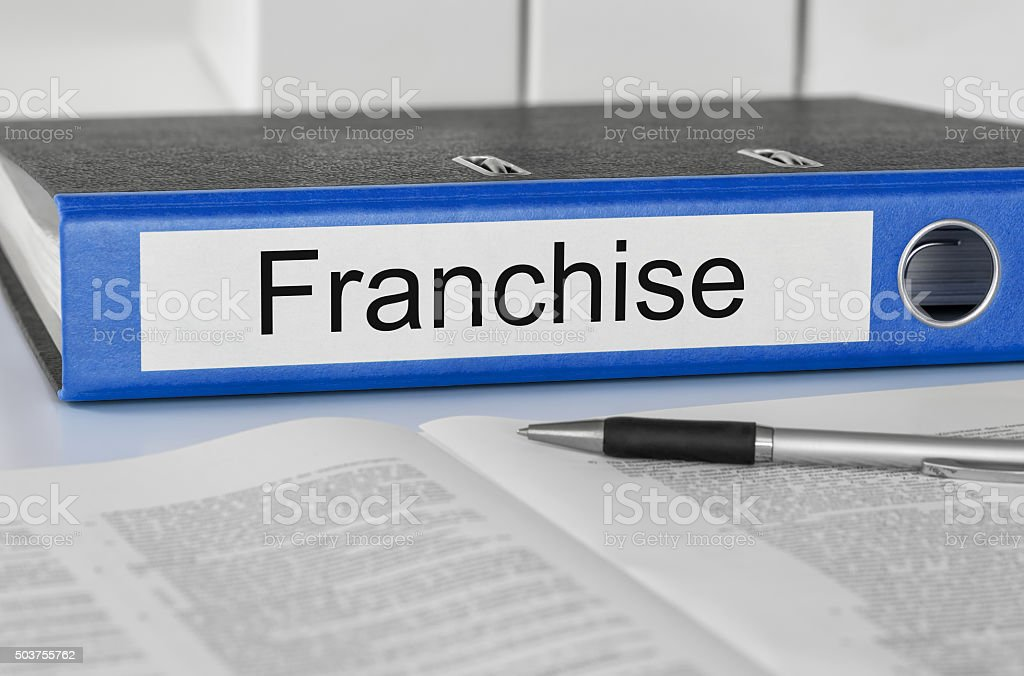 Folder with the label Franchise stock photo