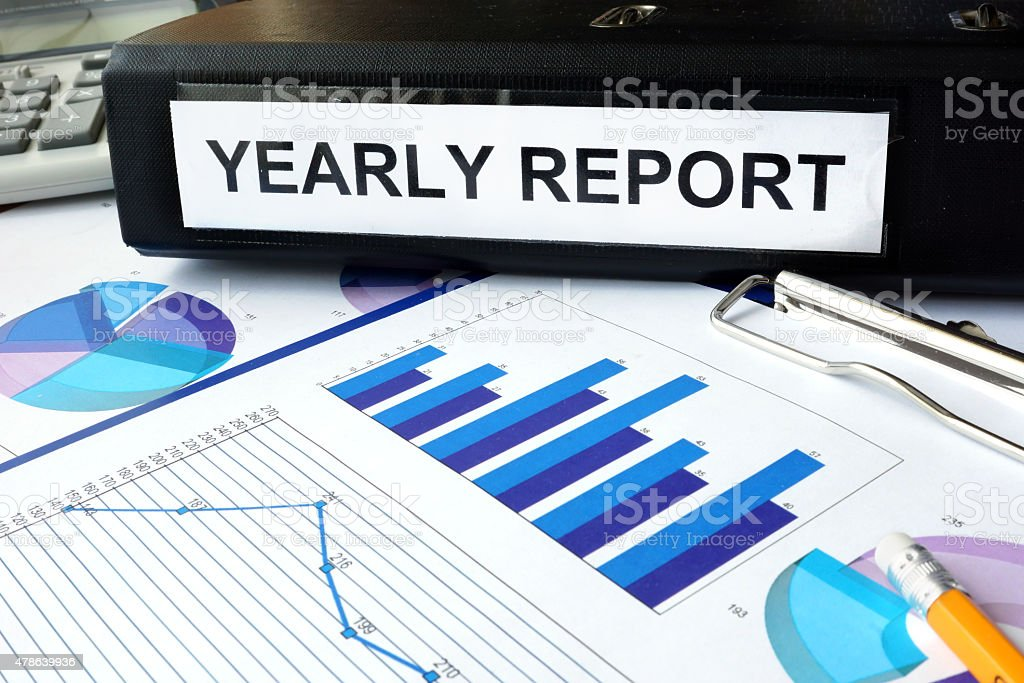 Folder with the label yearly report  and charts stock photo