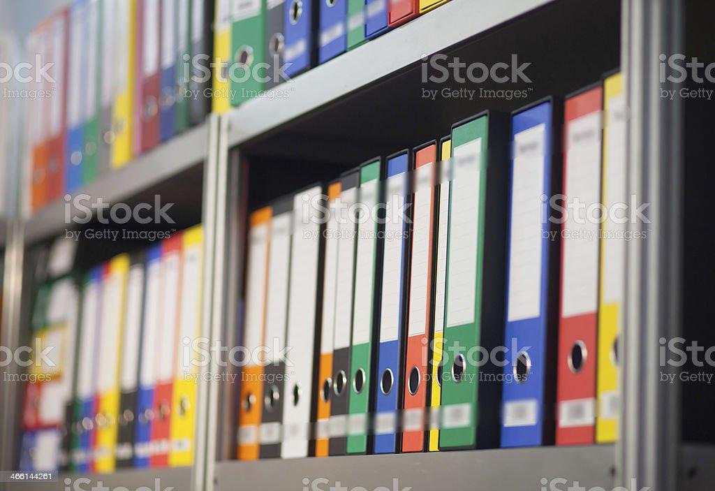 folders on bookshelf stock photo