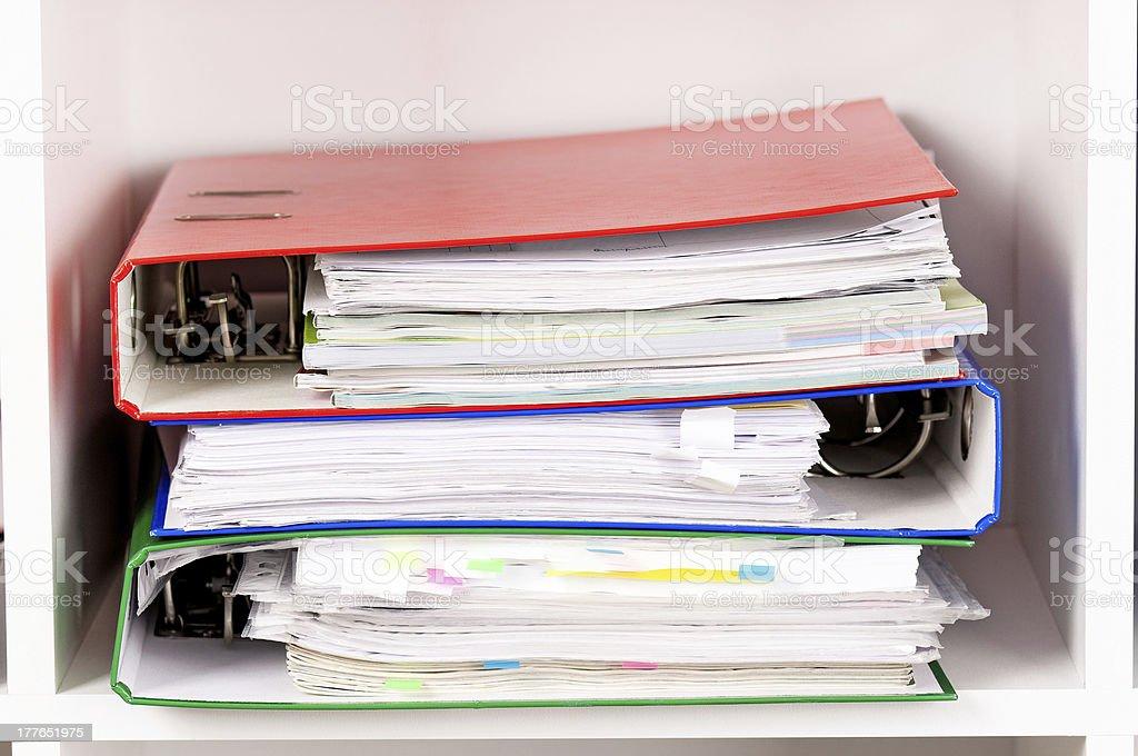 Folders on shelves royalty-free stock photo