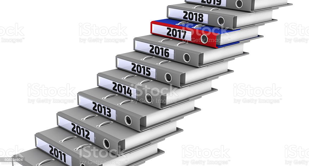 Folders stacked in the form of steps. Focus for 2017 stock photo