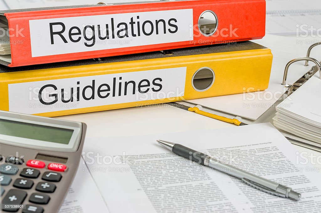 Folders with the label Regulations and Guidelines stock photo