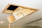 Folding Attic Access Ladder in a Garage