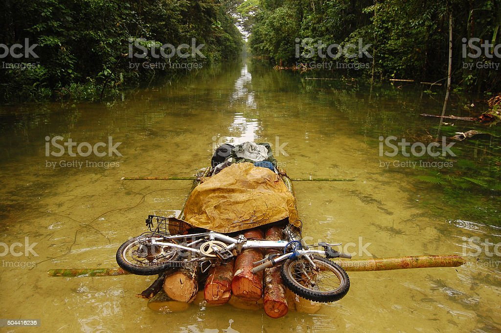 Folding bycicle at raft on flooded gravel road stock photo