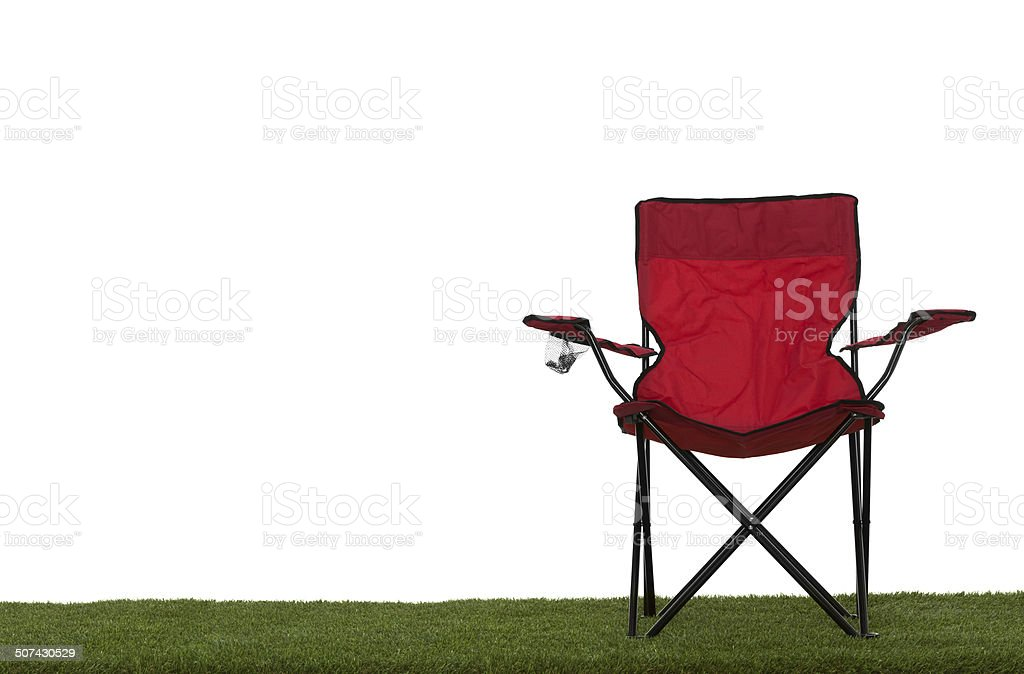 Folding camp chair front view on grass with white background stock photo