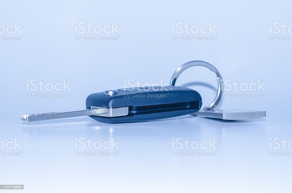 Folding car key with remote control blue toned stock photo