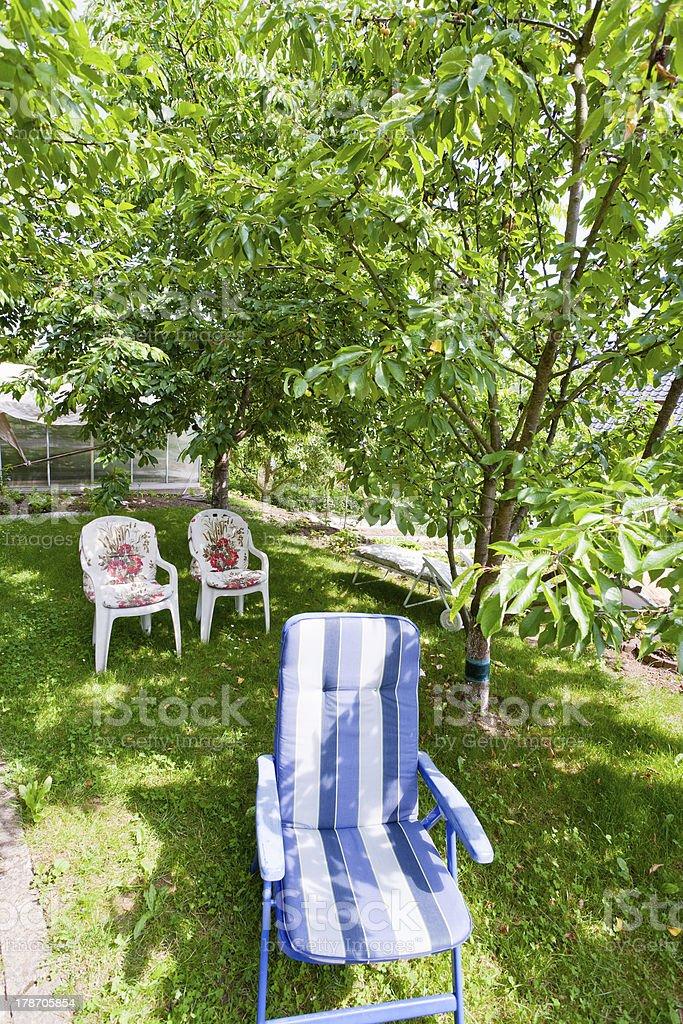 folding chair on backyard royalty-free stock photo