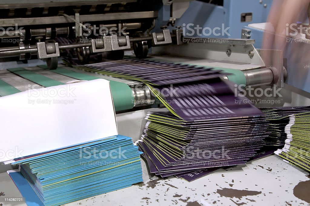 Folding Machine in Motion... stock photo