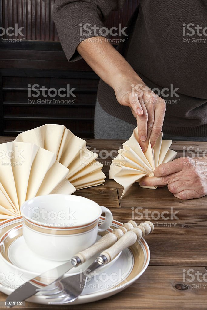 Folding napkins for lunch stock photo