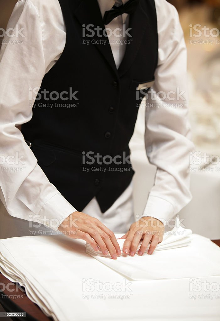 Folding napkins stock photo