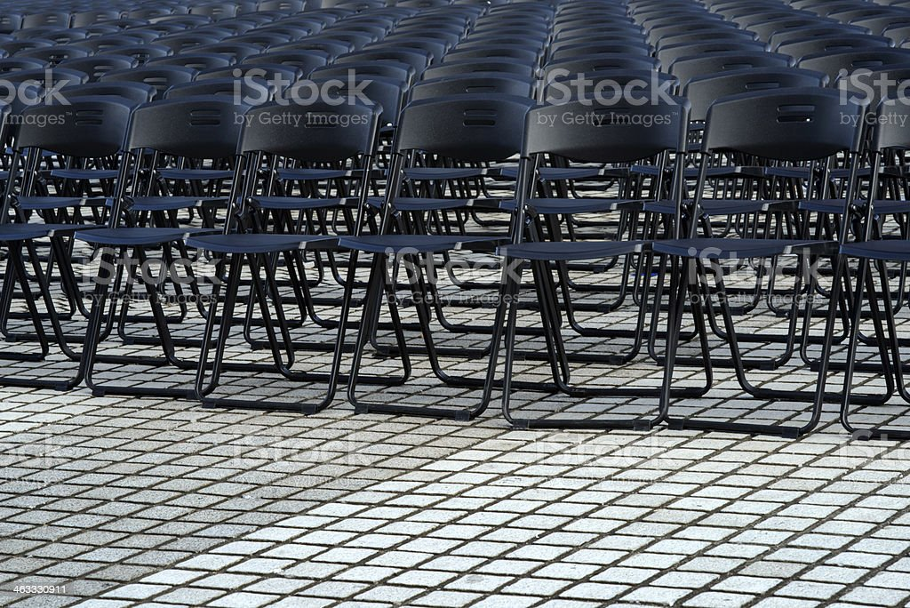 Folding plastic chairs for outdoor music concert stock photo