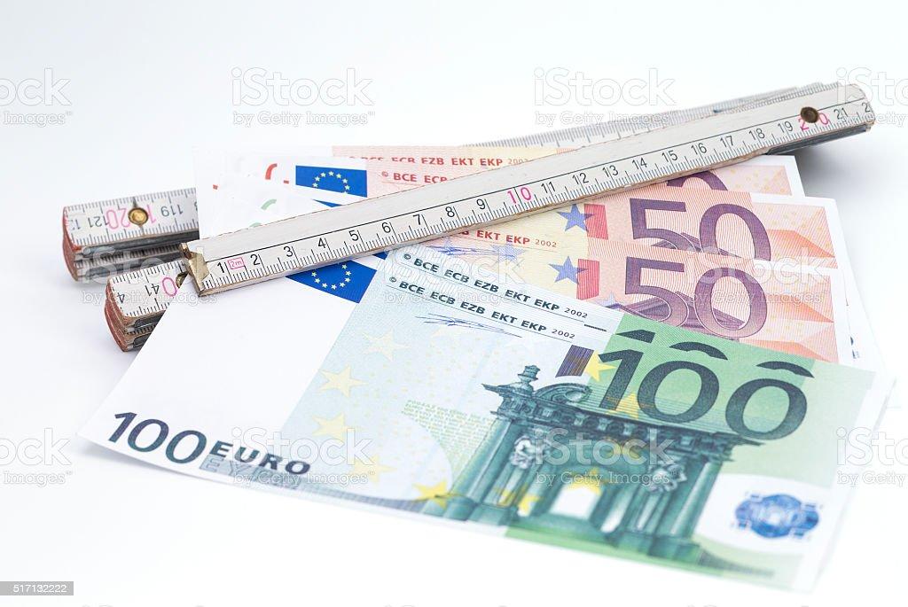 Folding rule with money stock photo