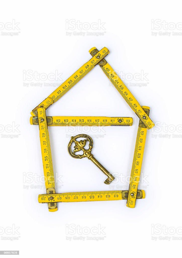 folding ruler, house shape and key royalty-free stock photo