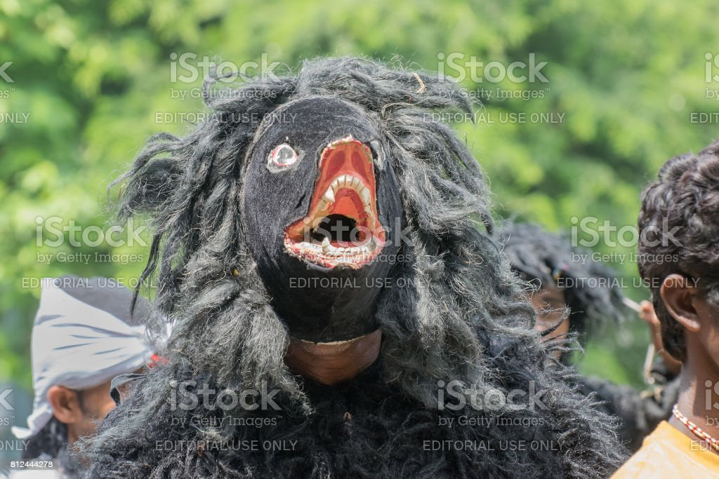 Folk dancer dressed as a bear marching past stock photo