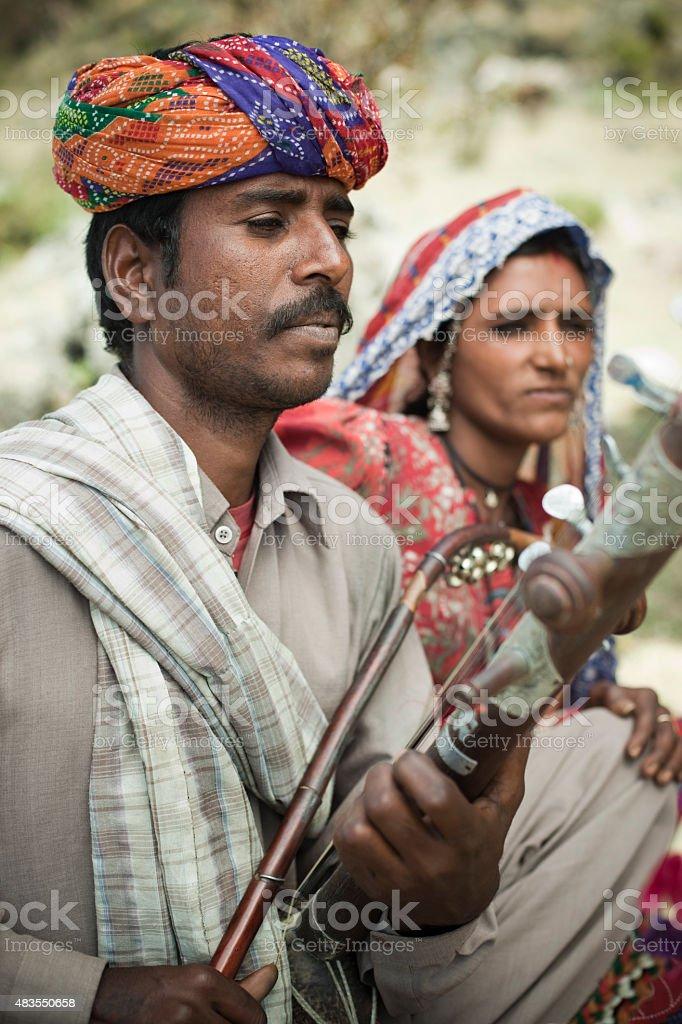 Folk musician couple of Rajasthan, India singing and playing Ravanahatha. stock photo