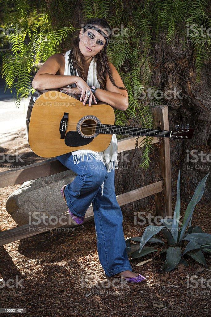 Folk Singer leaning on the fence stock photo