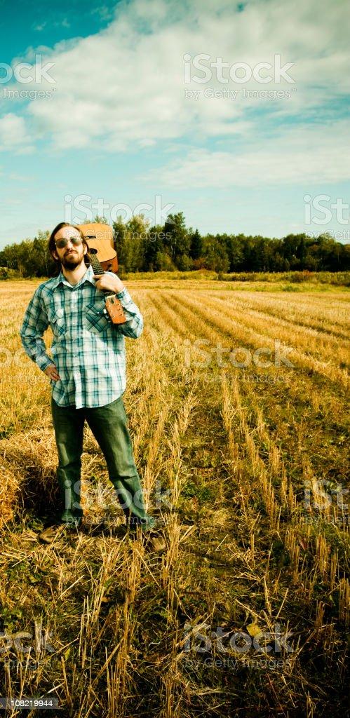 Folk singer on countryside stock photo