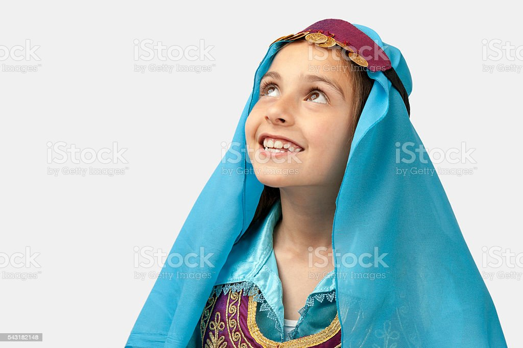 Folkloric girl looking up stock photo