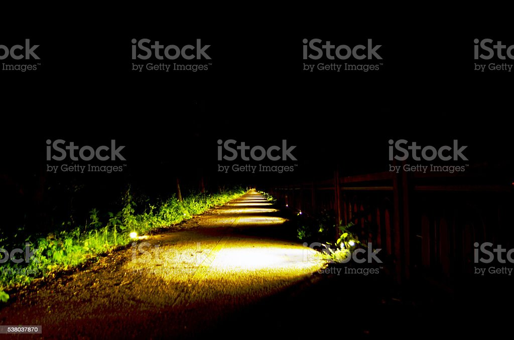 follow a trail at night stock photo