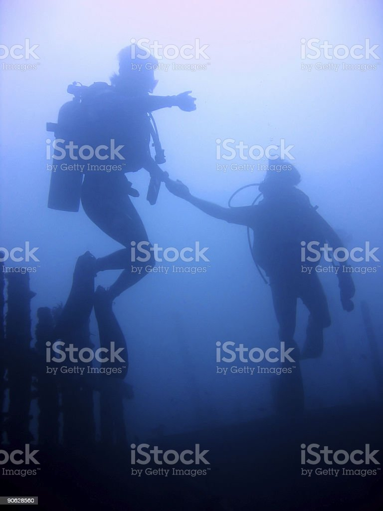 follow me scuba divers buddy team philippines royalty-free stock photo