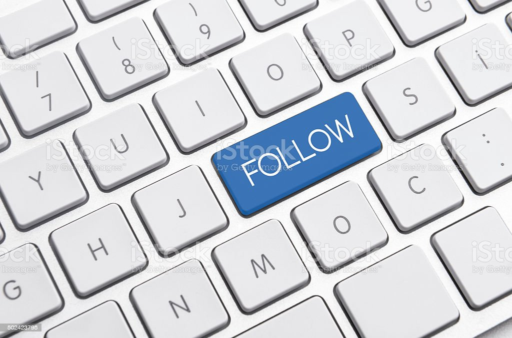 Follow me sign on computer keyboard stock photo
