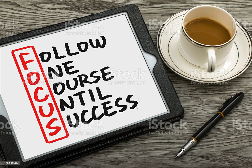 follow one course until success handwritten on tablet pc stock photo
