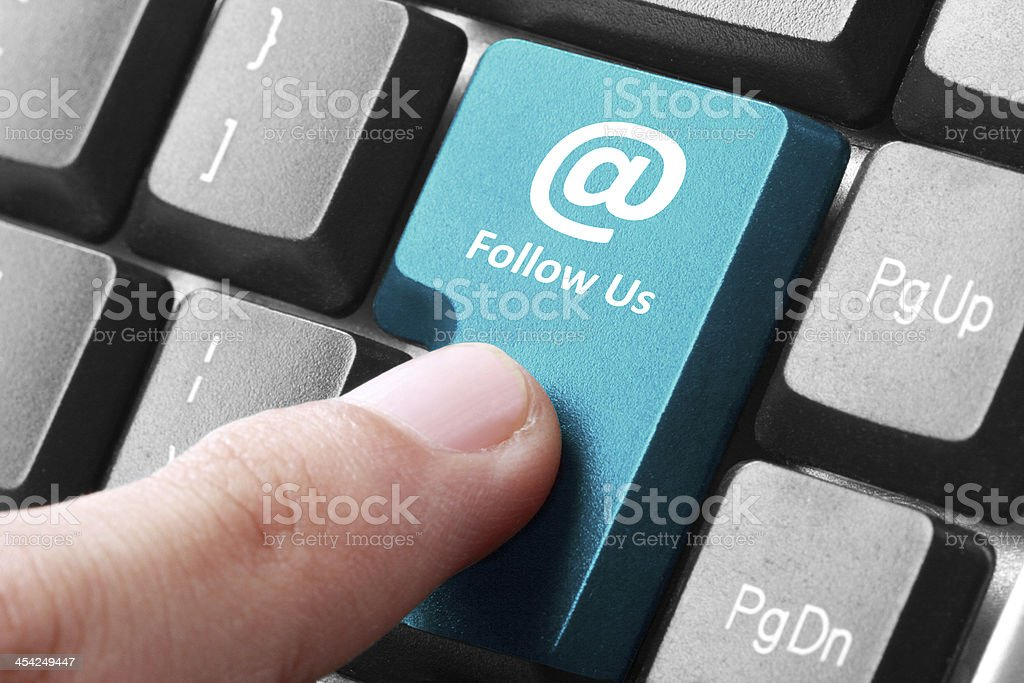 Follow us button on the keyboard royalty-free stock photo